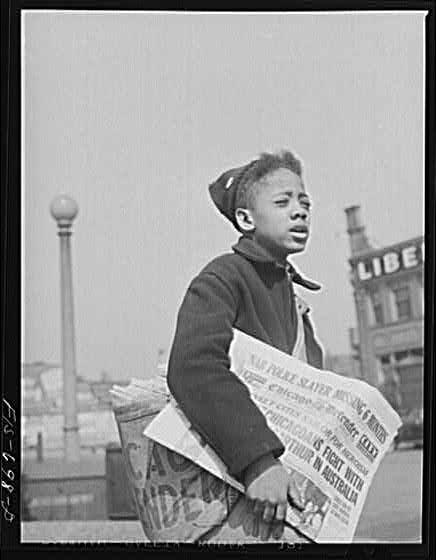 Boy selling Chicago Defender, 1942