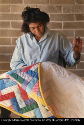 Lucy Abrams sewing a quilt as a member of the Freedom Quilting Bee, Alberta, Alabama, January 25, 1989.