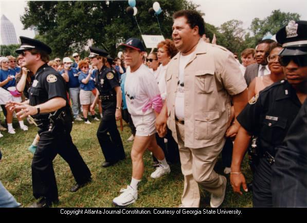Singer/Songwriter Elton John and Atlanta Mayor Maynard Jackson in AIDS walk, Piedmont Park, Atlanta, Georgia, July 1991.