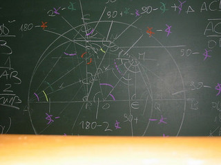 Geometry problem worked out on a chalkboard.
