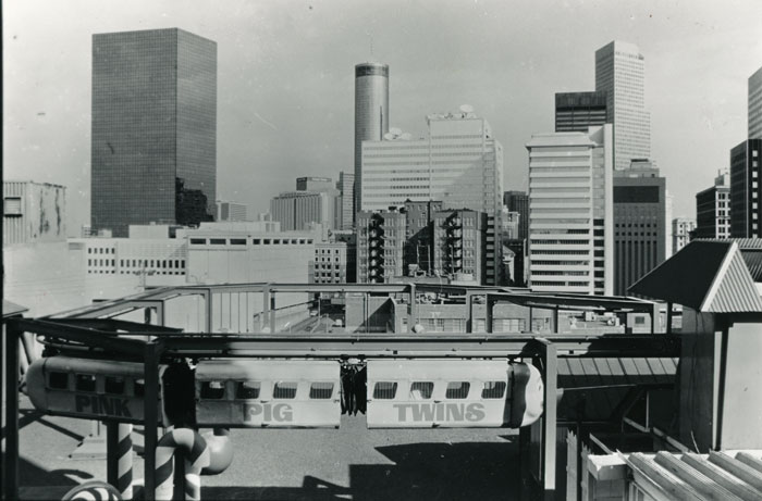 One of the Pink Pig Twins flying above Rich's downtown Atlanta rooftop in 1987. For decades, the monorail delighted children during the holidays. Copyright: Atlanta Journal-Constitution.