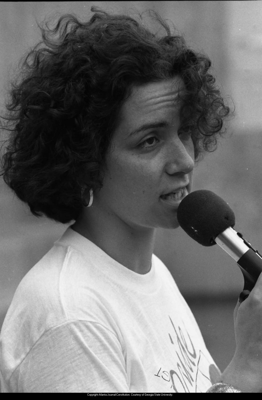 Woman at microphone, 1980 gay pride celebration, Atlanta, Georgia, June 21, 1980.