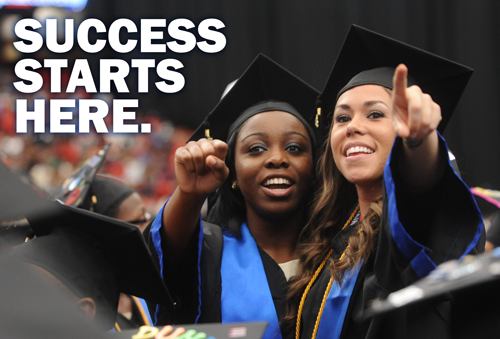 """Students graduating from Georgia State University with the slogan """"Success Starts Here."""""""