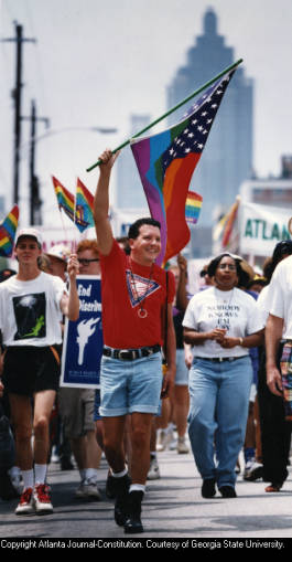 Jay Shoemaker leading group of marchers in the annual Gay Pride celebrations and parade, Atlanta, Georgia, June 27, 1993.