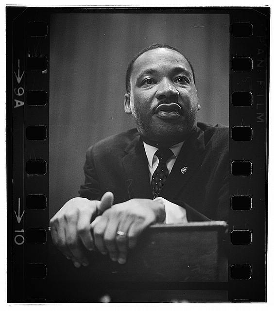 image of King leaning on a lectern, Martin Luther King Press Conference, March 26 1964