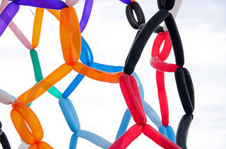 Closeup on a molecule model made out of balloons.