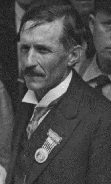 Close-up of stone cutter wearing ribbon