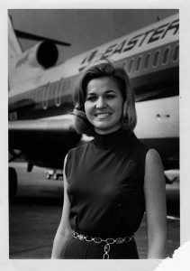 Carolyn Lee Wills beside an Eastern Air Lines aircraft, undated