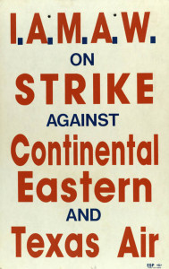 Machinists strike sign against three big carriers.