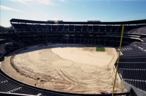 Installation of the playing field after reconfiguration of Olympic Stadium into Turner Field, March 1997 [AJCNL1997-03-12-01c]