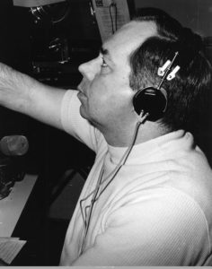 Station president Don Kennedy reading a morning broadcast for the Georgia Network